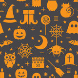 Seamless Halloween pattern. Seamless Halloween colourful orange and black pattern with festive Halloween icons. Design for wrapping paper, paper packaging Royalty Free Stock Photography