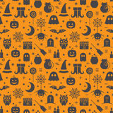 Seamless Halloween pattern. Seamless Halloween colourful orange and black pattern with festive Halloween icons. Design for wrapping paper, paper packaging Royalty Free Stock Image