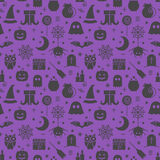 Seamless Halloween pattern. Seamless Halloween colourful violet and black pattern with festive Halloween icons. Design for wrapping paper, paper packaging Royalty Free Stock Photos