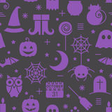 Seamless Halloween pattern. Seamless Halloween colourful violet and black pattern with festive Halloween icons. Design for wrapping paper, paper packaging Royalty Free Stock Image