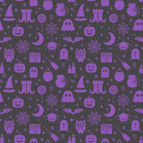 Seamless Halloween pattern. Seamless Halloween colourful violet and black pattern with festive Halloween icons. Design for wrapping paper, paper packaging Stock Photo
