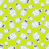 Seamless Halloween pattern with funny ghosts pattern. Vector background in cartoon style. Wrapping or textile design. Stock Photo