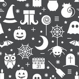Seamless Halloween pattern. Seamless Halloween monochrome black and white pattern with festive Halloween icons. Design for wrapping paper, paper packaging Royalty Free Stock Photos