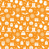 Seamless Halloween pattern. Seamless Halloween monochrome orange and white pattern with festive Halloween icons. Design for wrapping paper, paper packaging Royalty Free Stock Photo