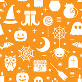 Seamless Halloween pattern. Seamless Halloween monochrome orange and white pattern with festive Halloween icons. Design for wrapping paper, paper packaging Stock Photo