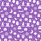 Seamless Halloween pattern. Seamless Halloween monochrome violet and white pattern with festive Halloween icons. Design for wrapping paper, paper packaging Royalty Free Stock Photography