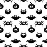 Seamless halloween pattern with pumpkin, owl, bat and spider ove. R white background Royalty Free Stock Photos