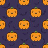 Seamless halloween pattern with scared kawaii style pumpkins on dark violet background with silhouettes of flittermouse. Seamless halloween pattern background Stock Photos