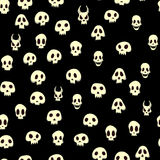 Seamless halloween pattern with skulls. Vector illustration,  on black background. Royalty Free Stock Image