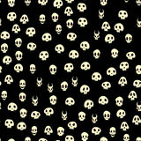 Seamless halloween pattern with skulls. Vector illustration, isolated on black background. Royalty Free Stock Image