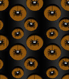 Seamless halloween pattern with spiders in holes over dark Royalty Free Stock Photography
