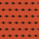 Seamless Halloween Pattern with Spiders over red Stock Photo
