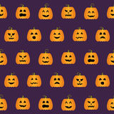 Seamless Halloween Pumpkin Faces pattern Royalty Free Stock Photo