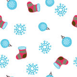 Seamless hand drawn background with snowflakes and Christmas boot. New Year`s pattern vector illustration