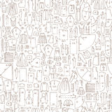 Seamless hand drawn doodle pattern with clothes and sewing Stock Photography