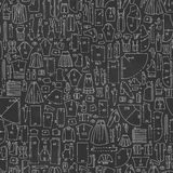 Seamless hand drawn doodle pattern with clothes and sewing Stock Image