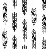 Seamless hand drawn geometric tribal pattern with feathers. Vector navajo design. Stock Images