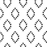 Seamless hand drawn geometric tribal pattern with rhombuses and triangles. Vector navajo design. Royalty Free Stock Photos