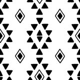 Seamless hand drawn geometric tribal pattern with rhombuses and triangles. Vector navajo design. Stock Photos
