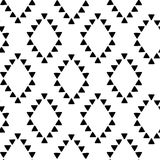 Seamless hand drawn geometric tribal pattern with rhombuses and triangles. Vector navajo design. Royalty Free Stock Images