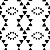 Seamless hand drawn geometric tribal pattern with rhombuses and triangles. Vector navajo design. Stock Photo