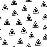 Seamless hand drawn geometric tribal pattern with triangles. Vector navajo design. Royalty Free Stock Photo