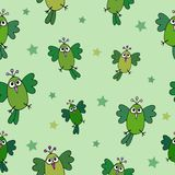 Seamless hand-drawn pattern with funny animation birds and stars. On the green background Royalty Free Stock Photography