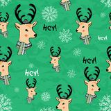 Seamless hand drawn pattern with new year deer on green background.vector.deer in a hat with a scarf. snowflakes.New royalty free illustration