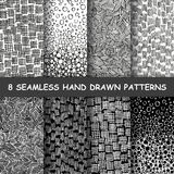 Seamless hand drawn pattern. Set of eight seamless hand drawn patterns. Graphic textures. Hand made background. Made in vector Stock Photos