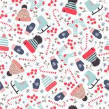 Seamless hand drawn winter pattern with knitted hats, socks and stock images