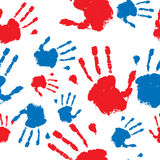 Seamless hand prints pattern. Grunge hand prints in red and blue seamless pattern background Stock Images