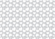 Seamless heart background in white and grey colors. A background composition of hearts in white and grey colors Royalty Free Stock Photography