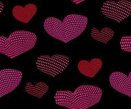 Seamless pattern of  pink and red hearts on a black background. Seamless heart pattern filled with stars and circles on a black ackground. Vector illustration Royalty Free Stock Photography