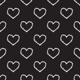 Seamless heart and thorns pattern on black Stock Photo