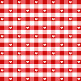 Seamless Hearts & Gingham. Seamless gingham pattern with hearts in Valentine Red for scrapbooks, albums, arts, crafts, fabrics, decorating. EPS8 file includes Stock Image