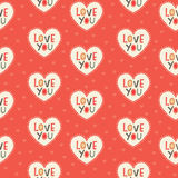 Seamless hipster hearts pattern in red and cream. Seamless hipster hearts background pattern with Love You text in red, gray and cream for Valentines Day or Stock Illustration