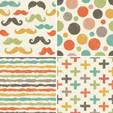 Seamless hipster patterns in retro colors. Set of seamless hipster backgrounds in retro colors. Rough hand drawn patterns with moustaches, dots, stripes, swiss Royalty Free Stock Image