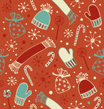 Seamless holiday Christmas pattern. Doodle lace backdrop with caps, scarfs, mittens and lollipops, sugarplums. Endless craft textu Stock Photography