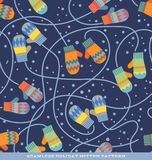 Seamless holiday pattern with colorful mittens and snow Stock Image