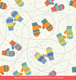 Seamless holiday pattern with colorful mittens and snow Royalty Free Stock Images