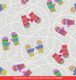 Seamless holiday pattern with striped mittens and snow Royalty Free Stock Image