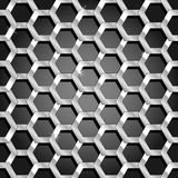 Seamless honeycomb pattern over black gradient. Interesting and dynamic seamless pattern made of thick silver honeycomb with depth over a black dark grey Royalty Free Stock Photo