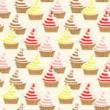 Seamless Iced Topping Cupcakes Pattern. Cupcakes with iced topping and sprinkles background Stock Photo