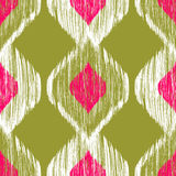 Seamless ikat pattern in pink and khaki colors. Vector tribal background. Stock Images
