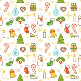 Seamless illustrated Christmas themed line style vector pattern. With snowman, Christmas trees, bells, presents, candles and other Christmas related objects Royalty Free Stock Photography