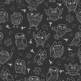Seamless illustration with contour images of cartoon owls , white outline on a dark background Stock Images