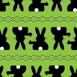 Seamless illustration - Easter bunny background. Background seamless illustration - black Easter bunny with white tail Royalty Free Stock Image