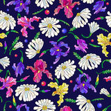 Seamless illustration with flowers and leaves of daisies and irises on a dark blue background. Seamless pattern with spring flowers in stained glass style Royalty Free Stock Photo
