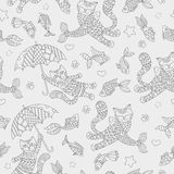 Seamless illustration  with funny cats and fish, a dark contour figures on a light background. Seamless pattern with funny cats and fish, a dark contour figures Stock Photography