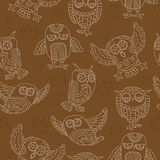 Seamless illustration with owls , contour drawings on brown background Royalty Free Stock Photos
